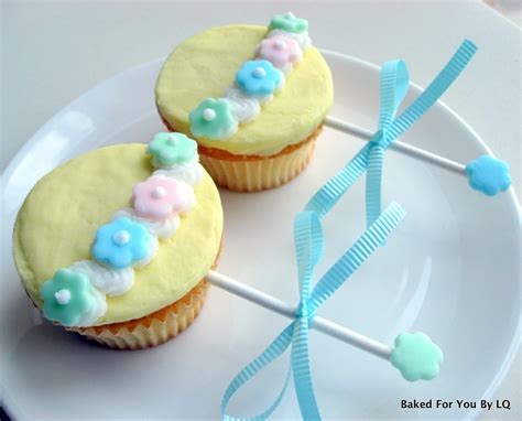 How To Decorate Cupcakes For Baby Shower by Baby Shower Rattle Cupcakes Baked For You