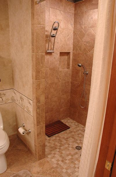 Need More Living Space Check Out These Lower Level Remodels Doorless Shower Small Bathroom