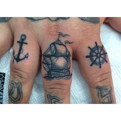 cool knuckle tattoos nautical finger tattoos venom