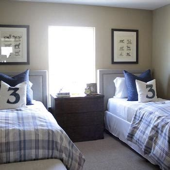 twin beds boy s room tufted headboards kids rooms shared kids nightstand design ideas