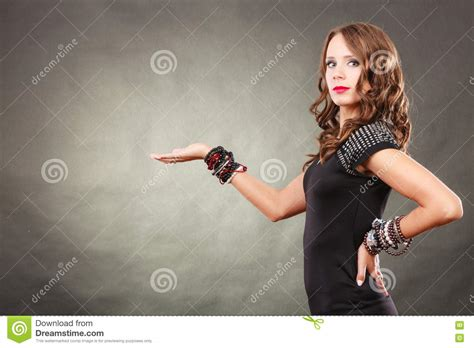 elegant mature woman wearing silver jewelry stock photo the elegant woman with jewellery in fashion concept