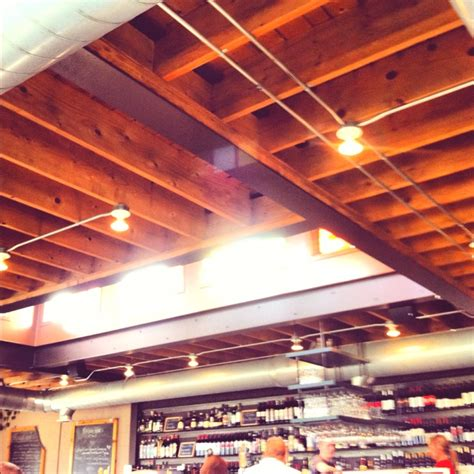the open ceiling and exposed beams and lighting