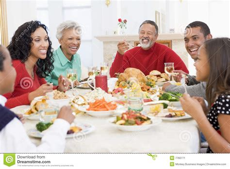 family all together at dinner stock image