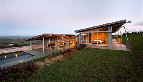 tiered  shaped slope home features exposed steel elements