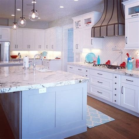Granite Countertops Salt Lake City by This Stunning Home Kitchen Features Alpine White