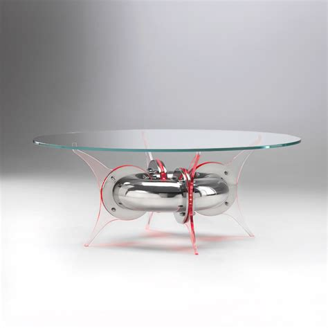table l with lighted round glass and steel coffee table with led light float by