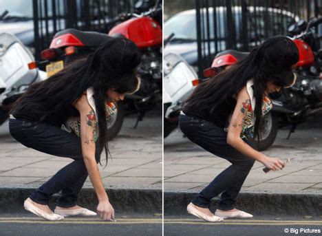 Winehouse Somehow Looks Better Not Done Up by Winehouse Stoops To A New Low Daily Mail