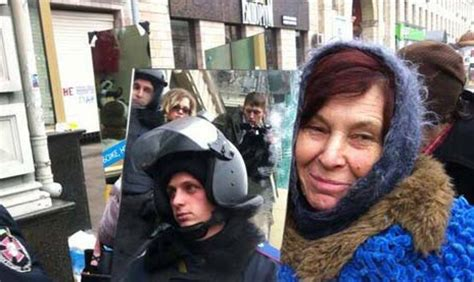 mirrors brought to protests: ukraine police forced to look
