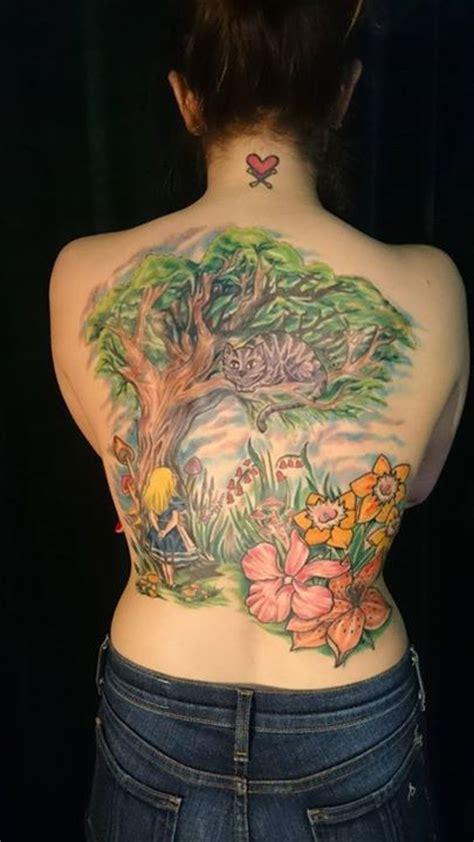 chest tattoo alice in wonderland alice in wonderland tattoo a full backpiece majestic