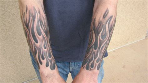 flame wrist tattoo black and grey half sleeve by steve