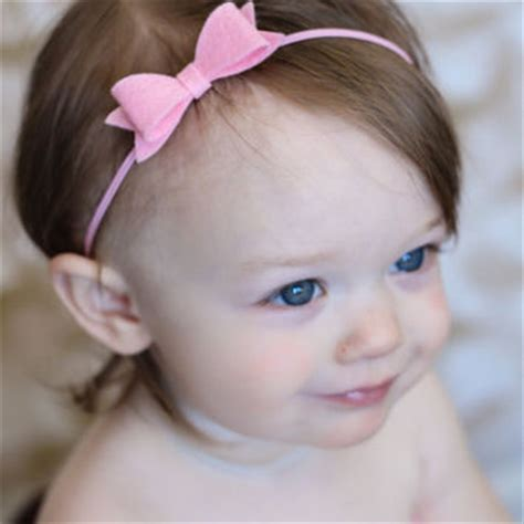 small bow headband pink felt bow from thepinkdaisyboutique on