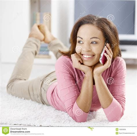 smiling girl using mobile phone in bed royalty free stock happy afro girl with mobile phone royalty free stock