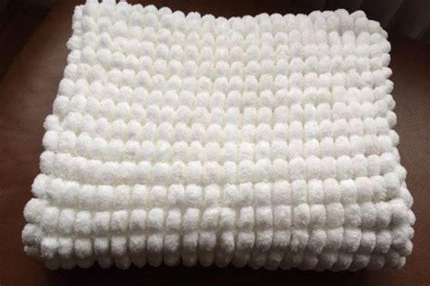 knitting pattern for pom pom baby blanket knitted marshmallow pom pom baby blanket 52 x 62 cm