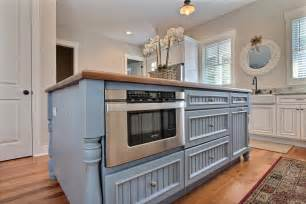 blue country kitchen island with built in microwave this country style kitchen features a large