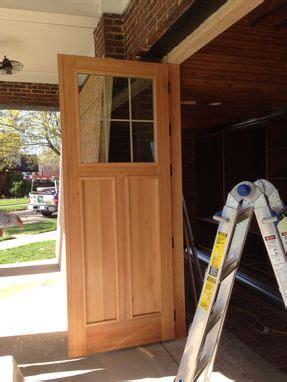 custom    douglas fir bi fold garage doors