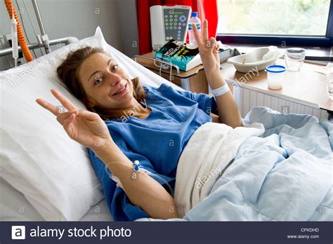 woman in hospital bed young woman recovering in hospital bed from orthodontic