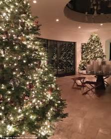 kourtney kardashian shows off her christmas trees after