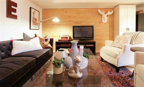 hgtv inspiration rooms wood paneled wall in basement living room incomeproperty