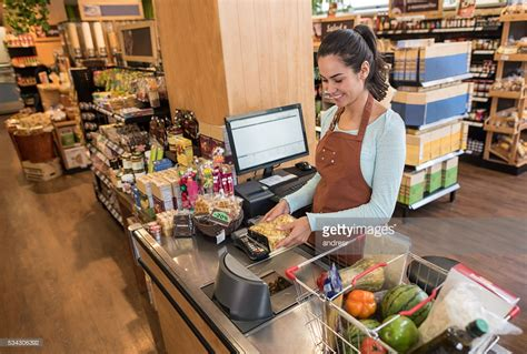 cashier working at a supermarket stock photo getty images