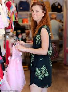 Daughter shopping alyson perused pink dresses for her eldest daughter