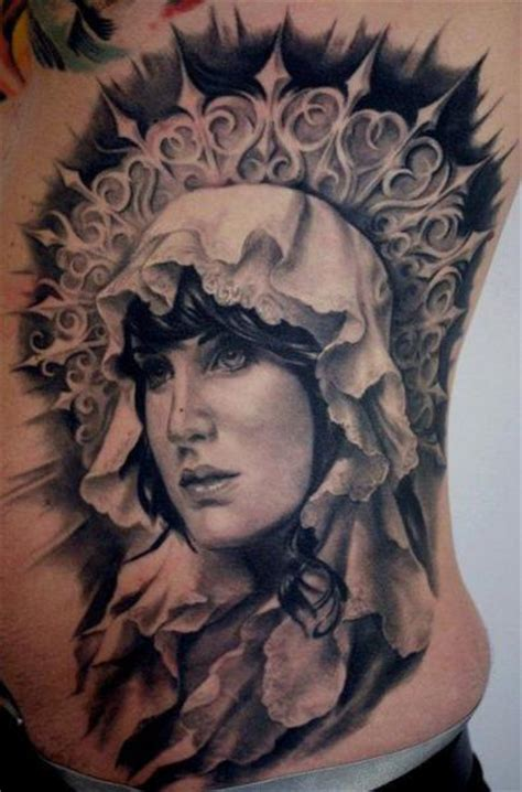 side religious tattoo by carlos torres