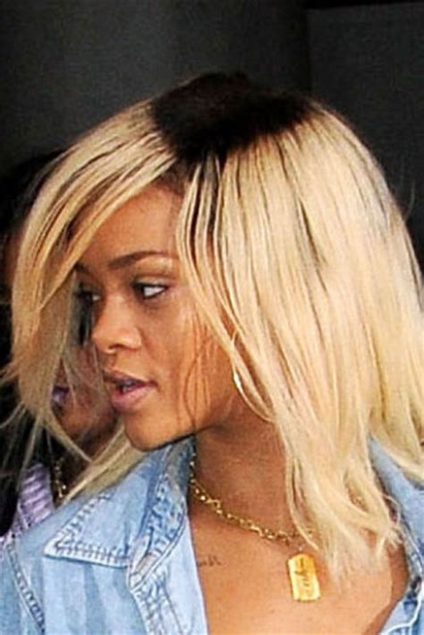 dark roots blonde hair rihanna debuts unusual new dark roots hairstyle marie claire