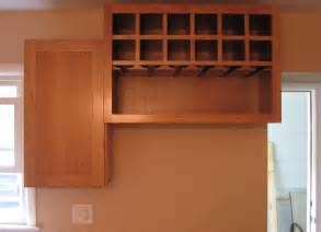Kitchen Wine Cabinets custom over the fridge wine cabinet