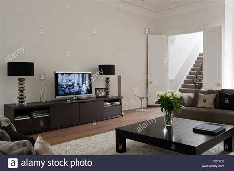 sideboard in living room flat screen and matching ls on sideboard in living room of stock photo royalty free image