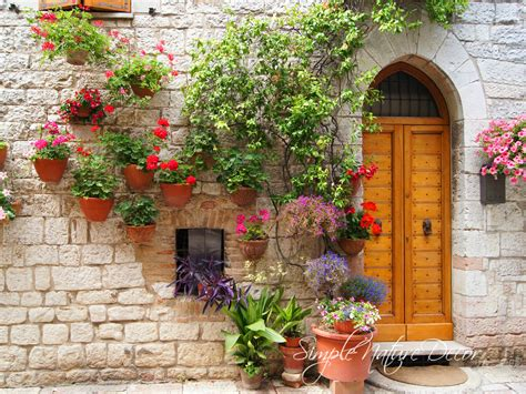 17 best images about tuscan floral on pinterest feathers brick wall flower tuscany pots on a wall doors and