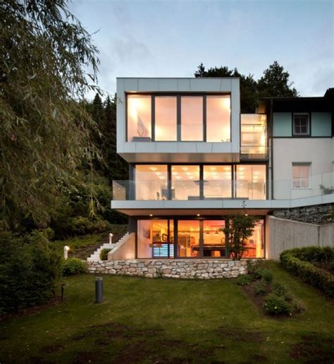 Modern Houses Floor Plans three storey extension to a lakeside house featuring an