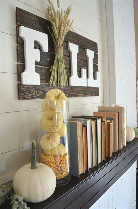 fall mantel books pumpkins vintage nest