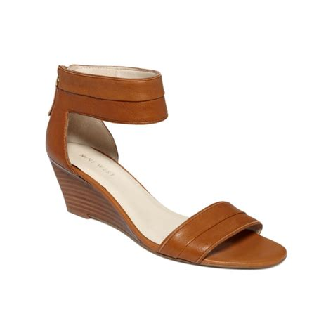 nine west sandals nine west packpunch wedge sandals in brown cognac lyst