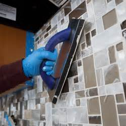 Grouting Kitchen Backsplash applying grout diagonally across tile backsplash