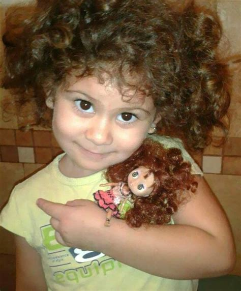 18 adorable children whose faces look exactly like their dolls