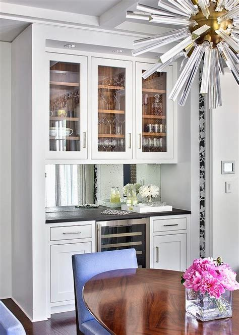 Kitchen Nook Cabinets | kitchen nook with bar cabinets and mirror backsplash
