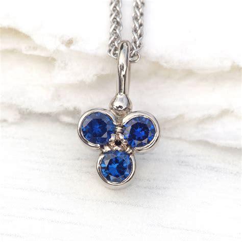 blue sapphire trefoil pendant in 18ct gold by lilia nash