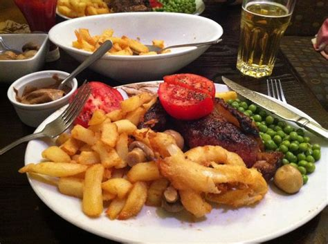 steak and omelette restaurant plymouth sirloin steak chips peas tomatoes mushrooms and