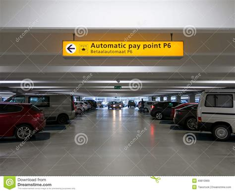 cars parked in parking garage at international airport