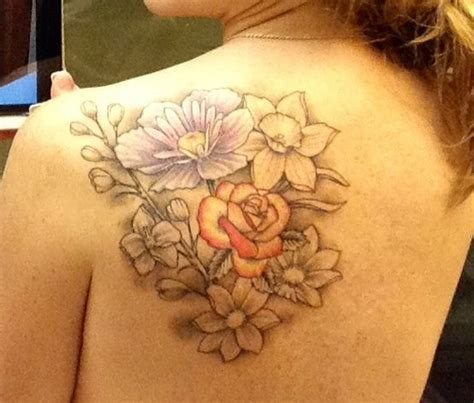 daffodil and rose tattoo back shoulder floral birth flowers