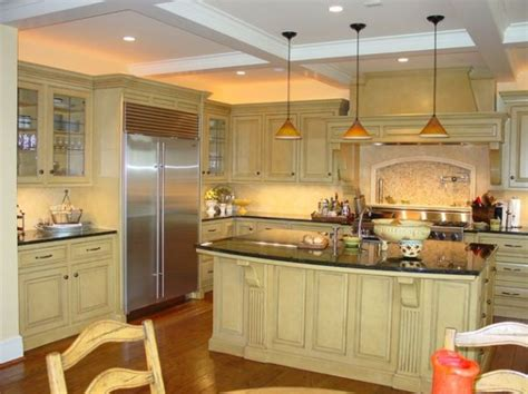 custom designed kitchen island with pendant lights bring