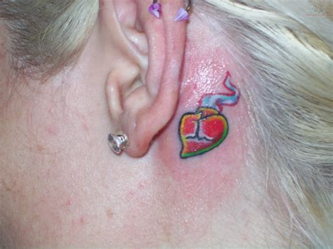 heart tattoo behind ear sacred ear