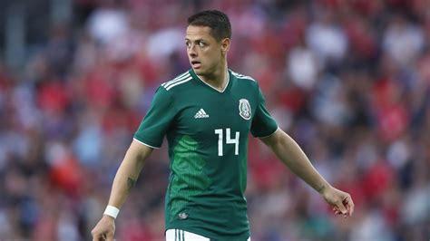 chicharito defends mexico snub focused  club
