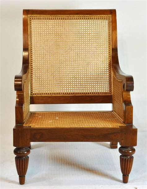 colonial chair and ottoman colonial imports caned leather plantation style
