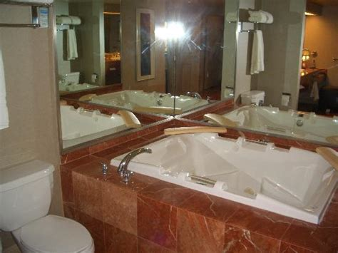 hotels with whirlpool bathtubs tv area in renovated rooms picture of treasure island