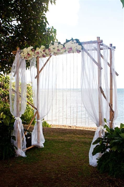 Bamboo chuppah with white chiffon fabric, flowers and