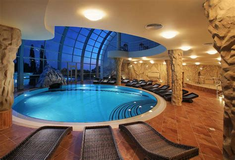 homes with indoor pools indoor swimming pool design plain wall paint closed tiny