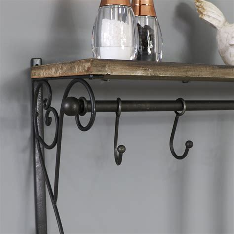 Black Wall Shelf With Hooks by Black Ornate Wall Shelf With Hooks Melody Maison 174