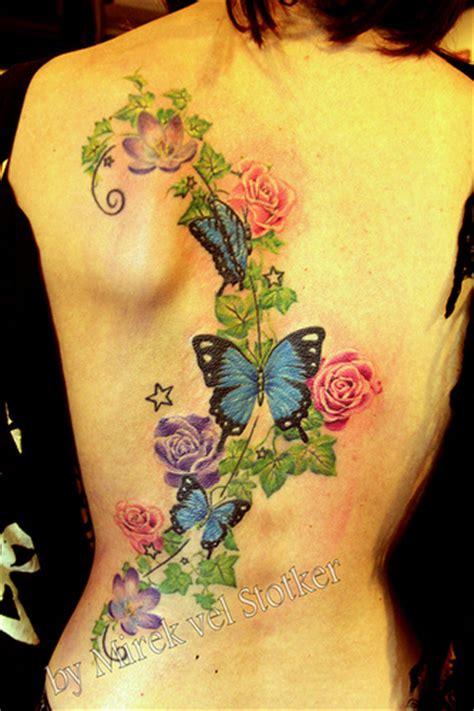 butterfly tattoo with vines and flowers flowers with butterflies tattoo by mirek vel stotker