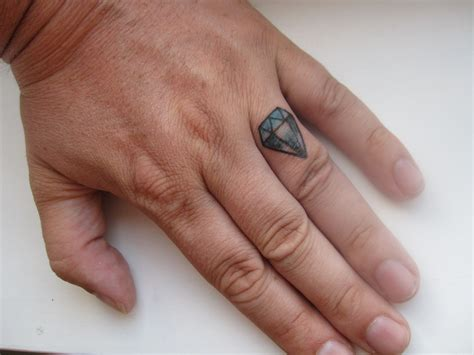 diamond tattoo on hand tattoos
