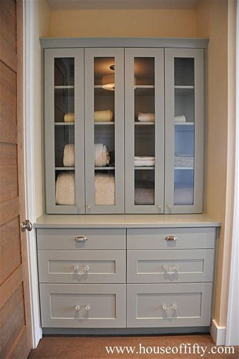 foyer built in cabinets turn hall linen closet into built in design ideas